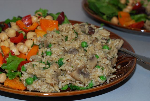 Masala Rice Pilaf with Mushrooms and Peas served on a plate
