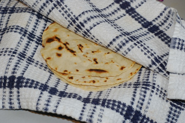 Place finished tortillas between the layers of a folded towel.