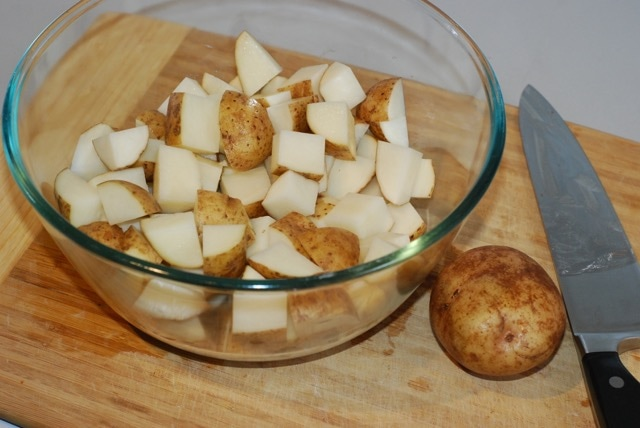 Chopped potatoes in a large mixing bowl