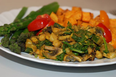 Greek Chickpea Scramble with mushrooms and spinach served with asparagus and roasted sweet ptoato