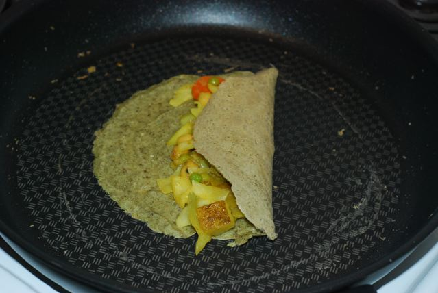 Mung Bean Crepes filled with Spiced Cabbage and Peas with Potatoes