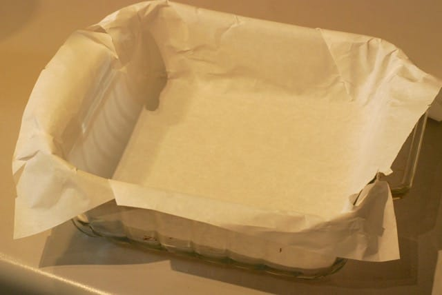 Ine a baking pan with parchment