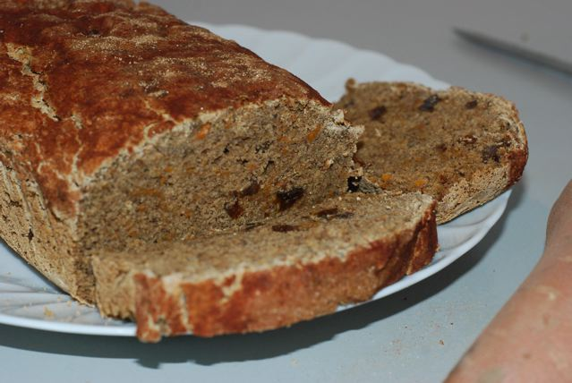 Sweet Potato Quick Bread sliced open to show the texture