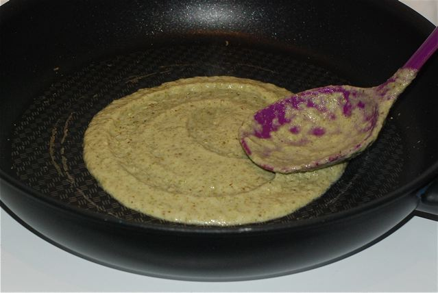 Spread the mung bean crepe batter with the back of a spoon