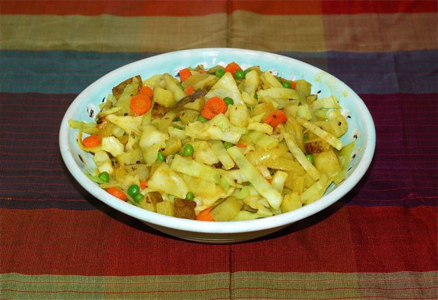 Finished Cabbage and Peas with Potatoes in serving dish