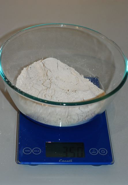 Gluten-free flour blend being weighed in a bowl