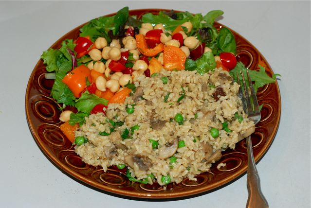 Masala Rice Pilaf with Mushrooms and Peas served with a simple salad
