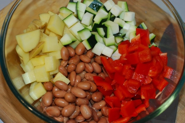 Vegetables and beans in a large mixing bowl