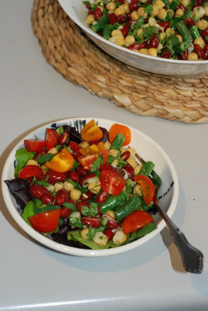 Three Bean Salad served on a bed of mixed green with chopped cherry tomatoes. Yum!