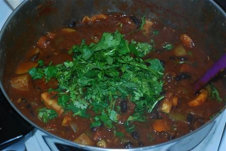 Add cilantro to the chili, sitr to mix in, and let sit for 5 minutes