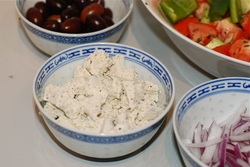 Place the onion, olices and soy feta in separate bowls