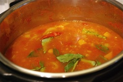 Open the lid and add the chili and the curry leaves