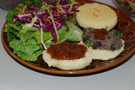Smokey Roasted Tomato and Ancho Chili Salsa served on arepas with salad and beans