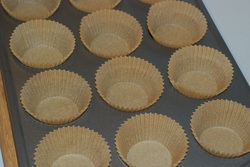 Muffin tray with parchment paper liners
