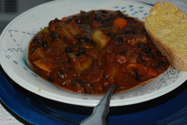 Black Bean and Potato Chili served with a slice of cornbread