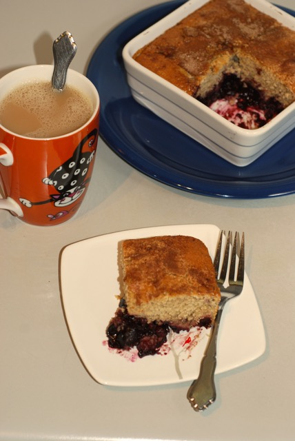 Slice of the Cherry Cobbler with a hot mug of chai tea