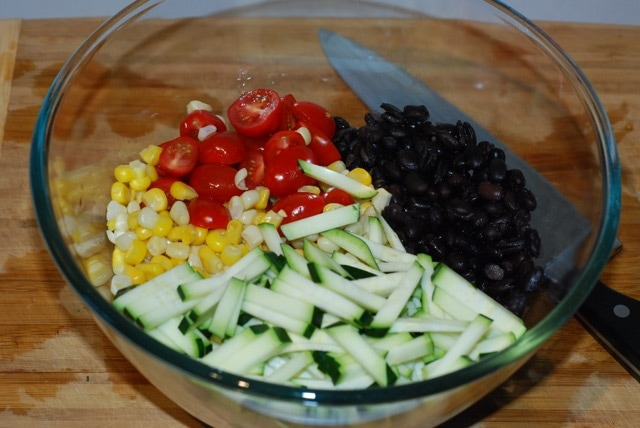 Salad ingredients in a mixing bowl