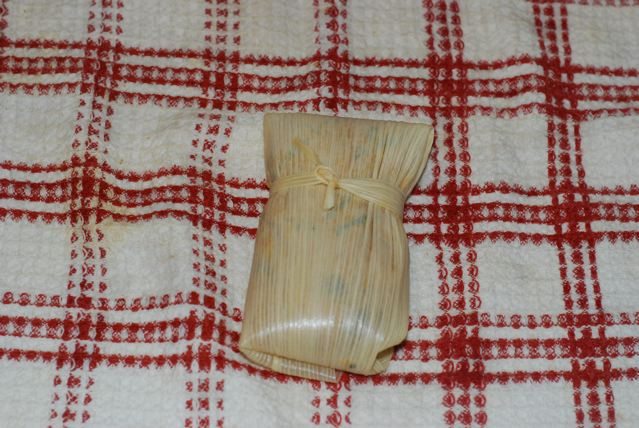Securely wrap the parcel with strip of corn husk and tie