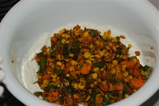 Cooled vegetables added to the corn masa in the bowl