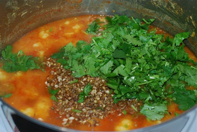 Add the seeds and cilantro to the cooked soup