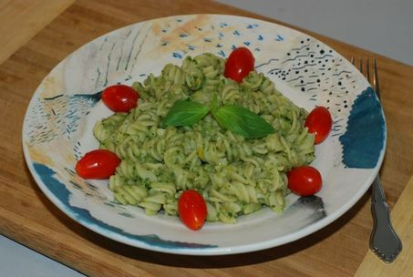 White Bean Pesto served on pasta and garnished with grape tomatoes